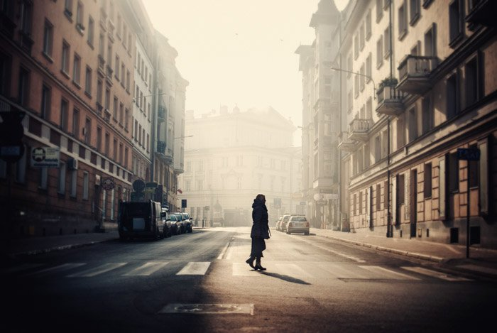 Shadowy photo of a woman crossing the street