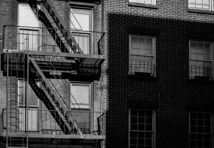 Black and white photo of the exterior of a building
