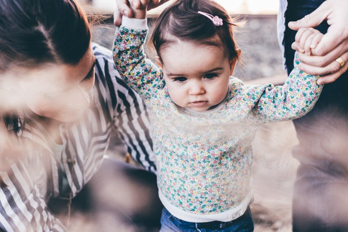 lifestyle family photography of a couple with a little girl
