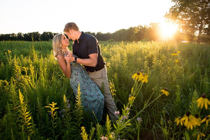 family photography of a couple dancing in a field
