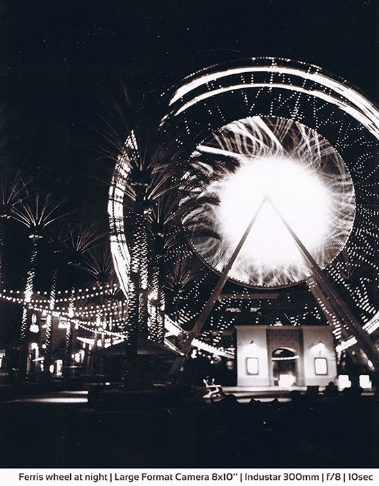 Positive paper film photography of a ferris wheel
