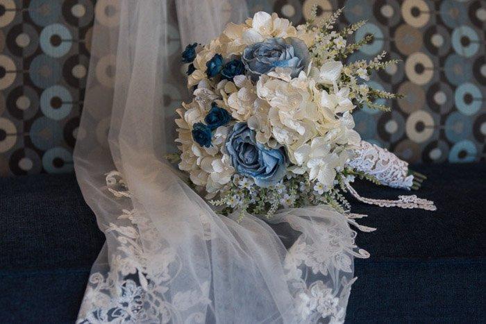 A wedding bouquet on a veil