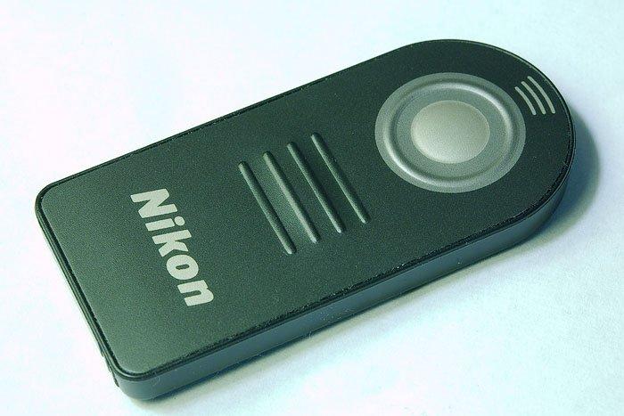 A black Nikon remote control - Landscape photography gear