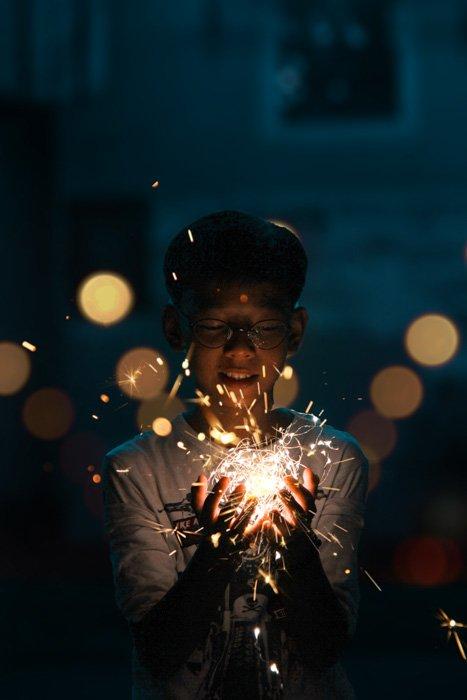 A little boy holding a ball of fairy lights