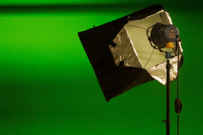 A lighting modifier set up in a photography studio
