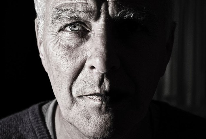 Black and white close up portrait of an old man