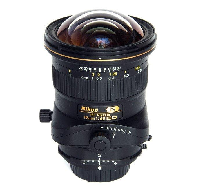 A Nikon Tilt-Shift lens on white background