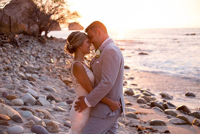 Soft dreamy wedding photograph of a newlywed couple embracing on a beach. Amateur Wedding Photography