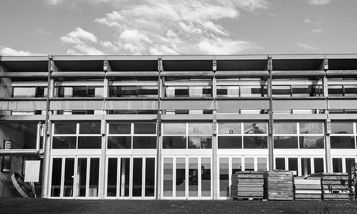 Black and white front view of the multilayered, multi windowed Student Union Building, University of Canterbury, New Zealand.