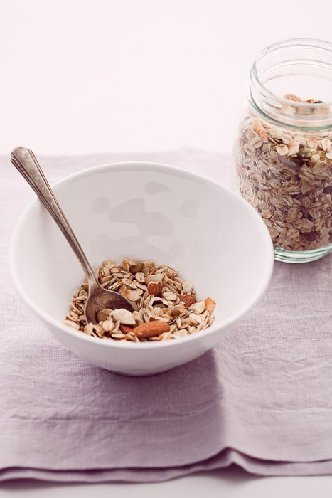 Food photography of granola in a bowl on a linen napkin