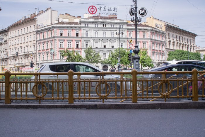 A street scene in Budapest showing cars and buildings but empty of people