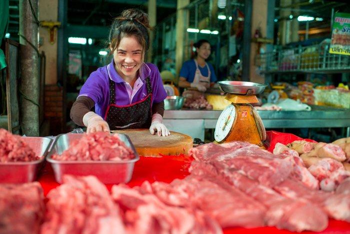 Lady in a market selling meat