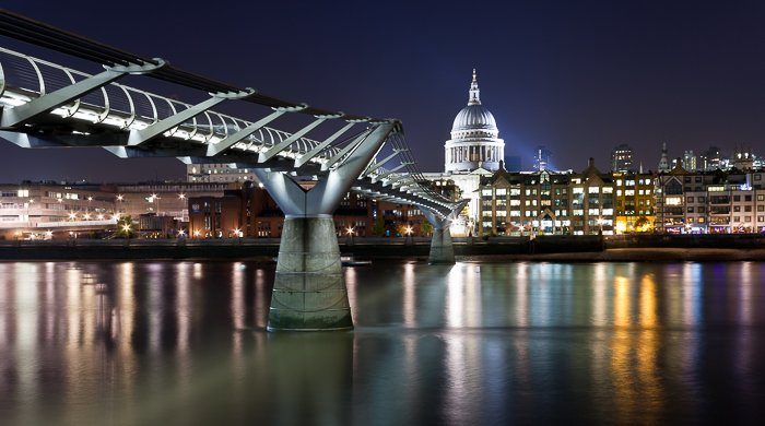 Stunning night cityscape with a river in the foreground