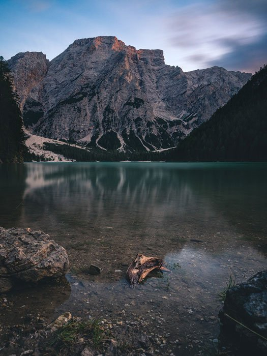 A mountainous landscape surrounding a lake.