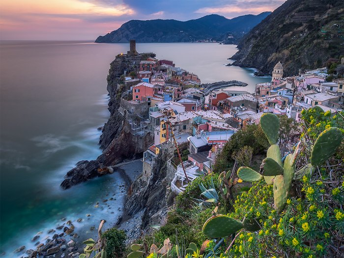 Long-exposure photography of a coastal town and seascape in Italy.