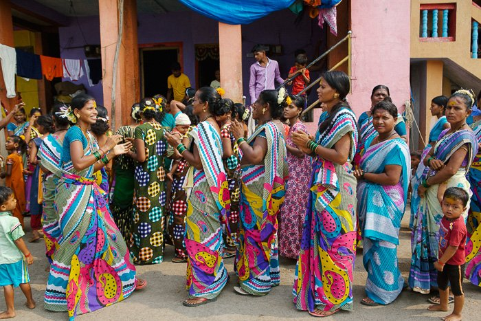 Travel photography of a group of colourfully dressed women on the streets in India.