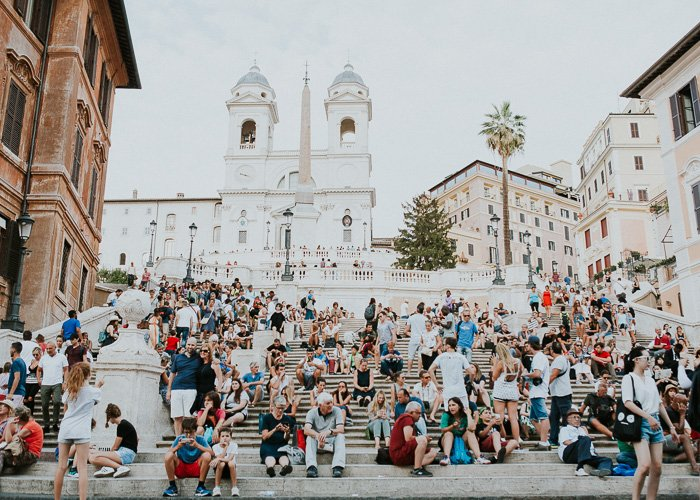 Travel photography of crowds of tourists in Rome.
