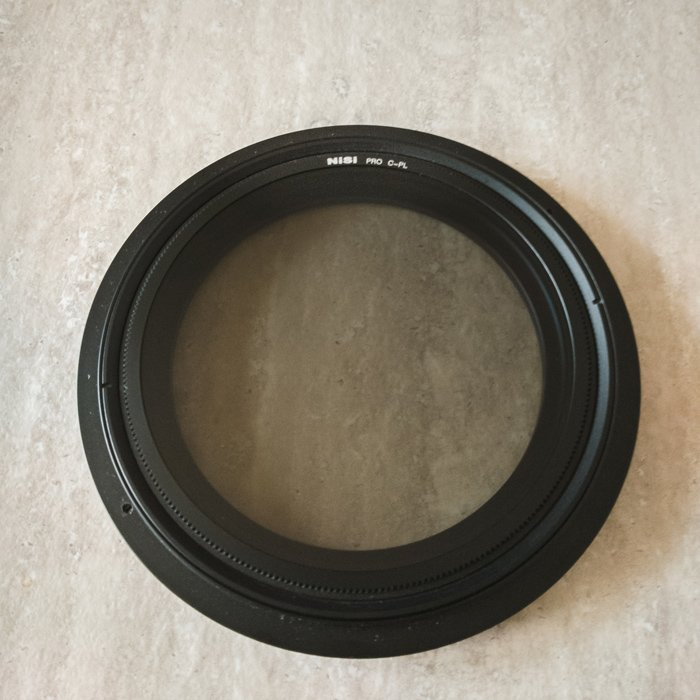 Close up image of a polariser filter or CPL for taking waterfall photos