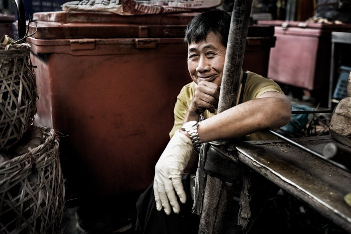 Documentary photography portrait of a man at Muang Mai Market, Chiang Mai, Thailand.
