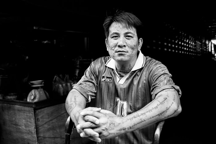 Black and white documentary photography of a portrait at a market in Chiang Mai, Thailand