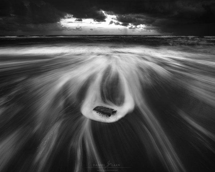 Luminous fine art landscape photography shot of the seashore in black and white