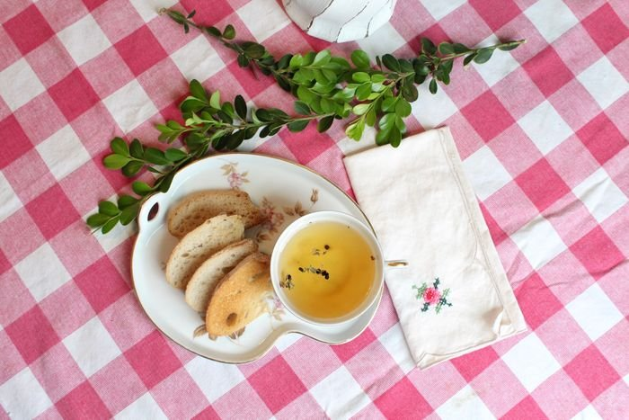 a plate of food on a pink checkered tablecloth