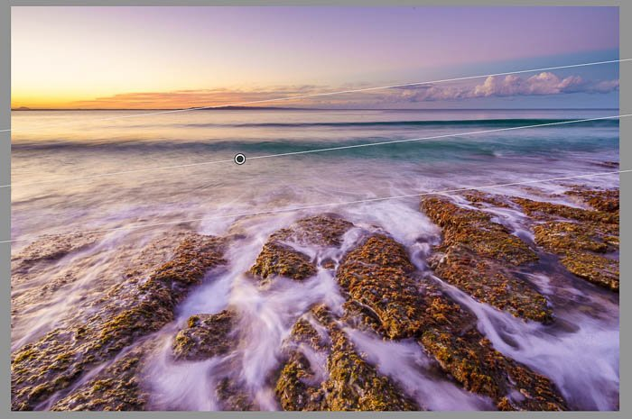 Screenshot of seascape photography being edited using Lightroom graduated filter tool