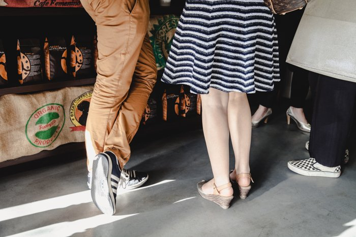 Stock photography showing the legs of three people.