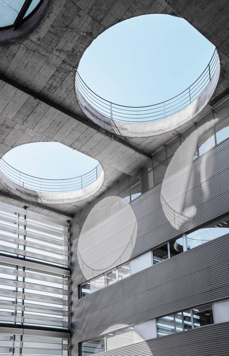 Architecture photography where the holes in the ceiling cast circular shadows - juxtaposition examples in photography
