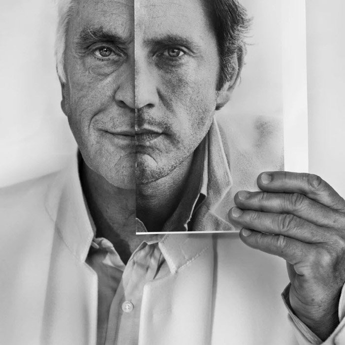 A photograph of Terence Stamp holding a photograph of his younger self juxtaposed on his face