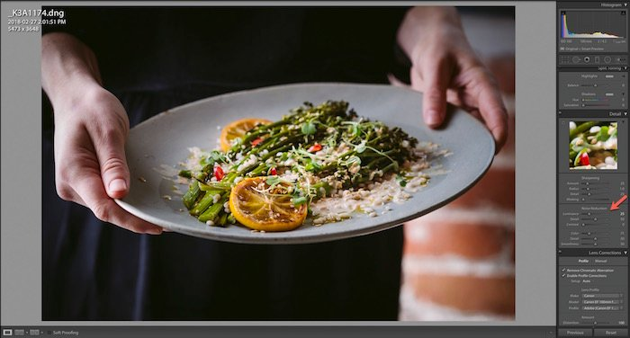 Shot of Adobe Lightroom interface editing a close up of a person holding a plate of salad.