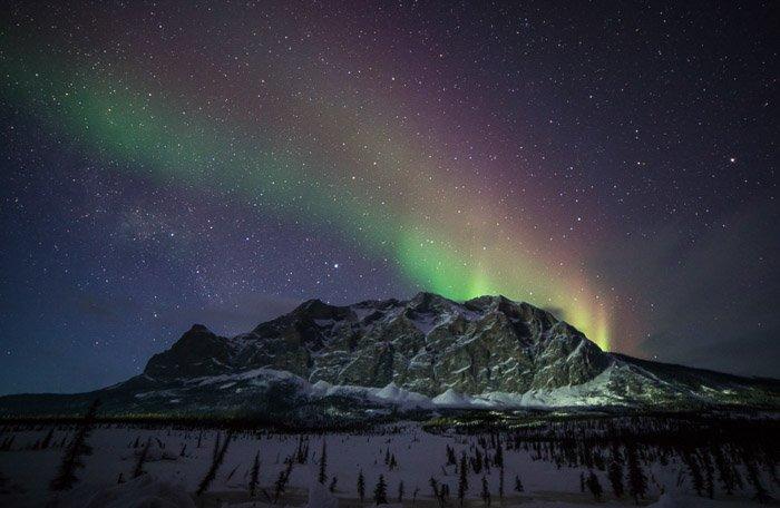 Multi coloured Aurora Borealis lights over Sukakpak Mountain in northern Alaska.