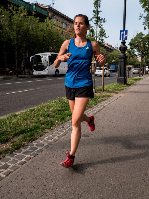 Street photography of a female runner in Budapest, taken with a Panasonic gh5 by Craig Hull