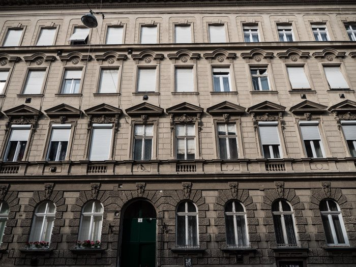 Street photography of the exterior of an apartment building in Budapest, taken with a Panasonic gh5 by Craig Hull