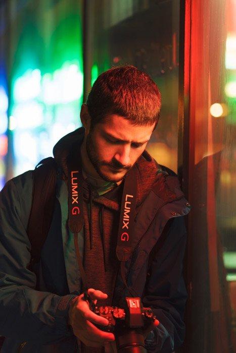 Portrait of a photographer holding a Panasonic gh5 camera