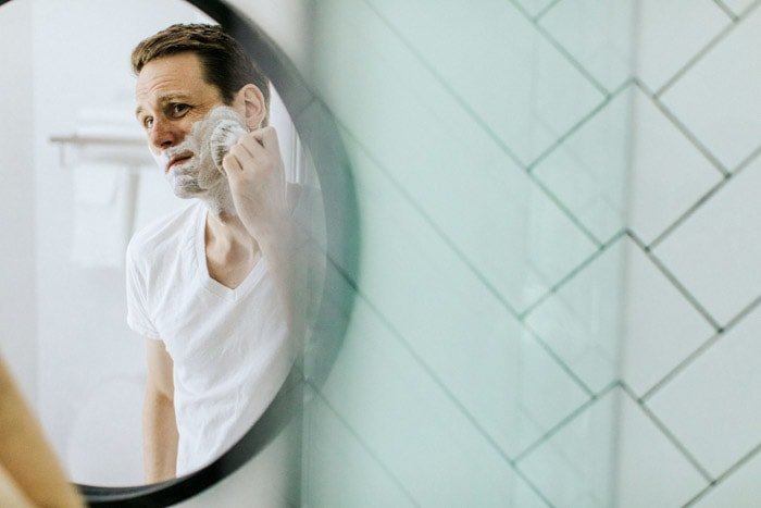 Portrait photography of a man shaving in the mirror. Photo essay examples.