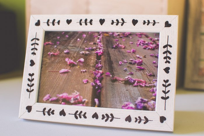 A photograph of a pink flowers in a wooden frame. Photography ideas.