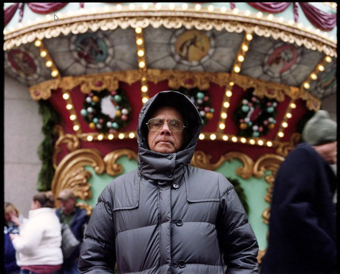 Emily Kai Bock portrait of a man in grey jacket and hood. Famous Portrait Photographers