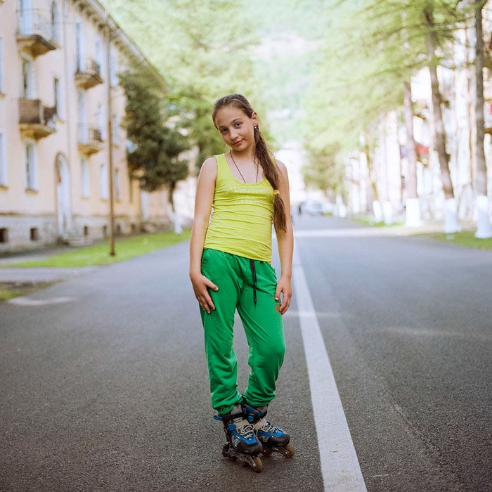 Maria Gruzdevaportrait of a young girl standing in the middle of the road. Famous Portrait Photographers