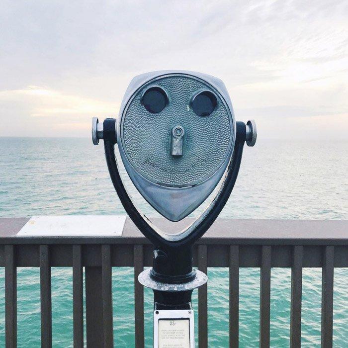 Photograph of a landscape view finder against a seascape background.