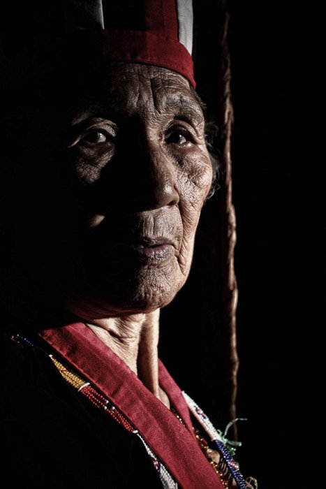 Travel photography portrait of a tribal shaman in Borneo.