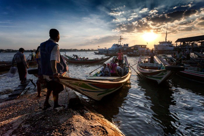 Busy harbour scene with people and boats at sunset - Street photography, photographing strangers