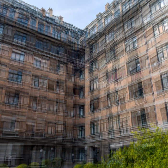 A blurry layered image of a tall apartment building achieved through intentional camera movement and image stacking