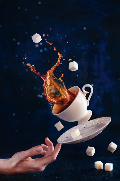 A creative photography still life with falling coffee cups on dark background