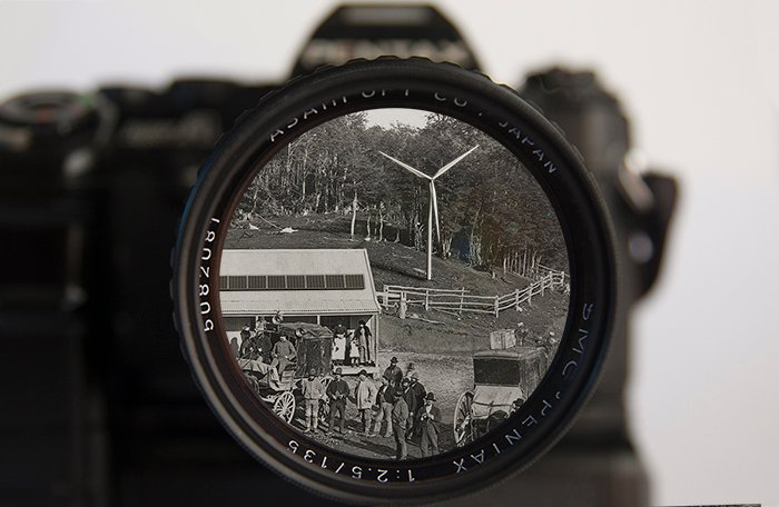 Composite of a wind turbine, photovoltaic cells, 1980s film camera, and 1880s photograph.