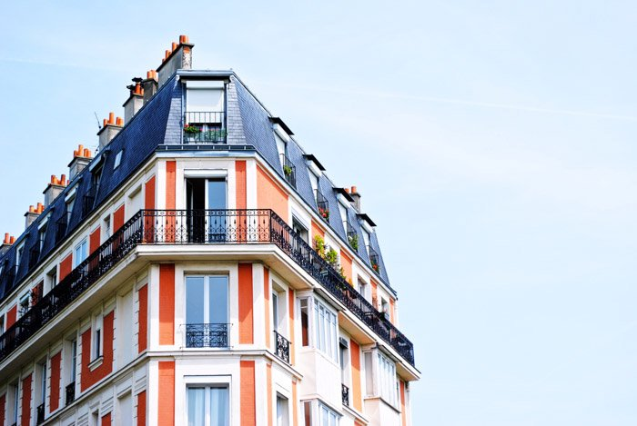 Top of a colorful multi windowed building demonstrating asymmetrical weight balance in photography