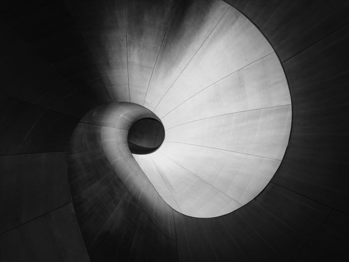 Abstract architectural photography demonstrating asymmetrical weight balance in photography