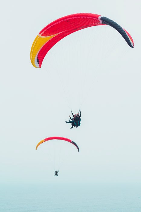 Para gliders free falling through the air demonstrating Size Weight Balance