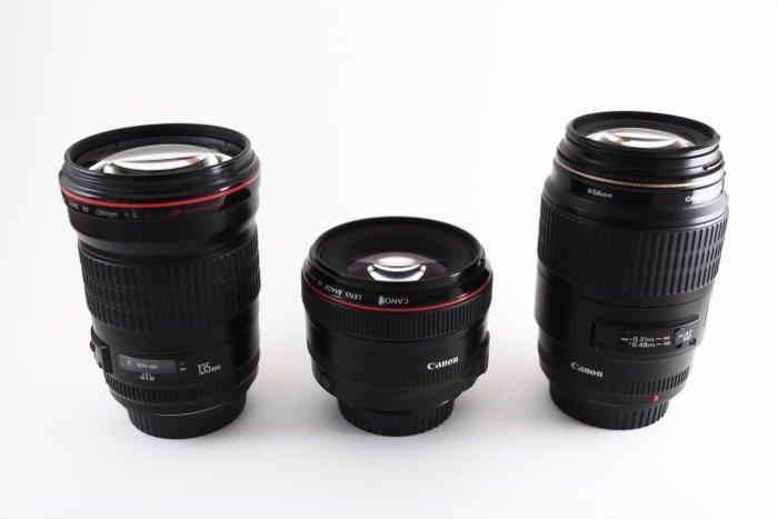 Image of 3 prime lenses on a white background