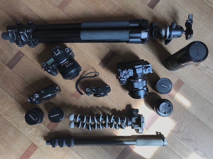 Overhead shot of photography equipment - best way to backup photos when travelling